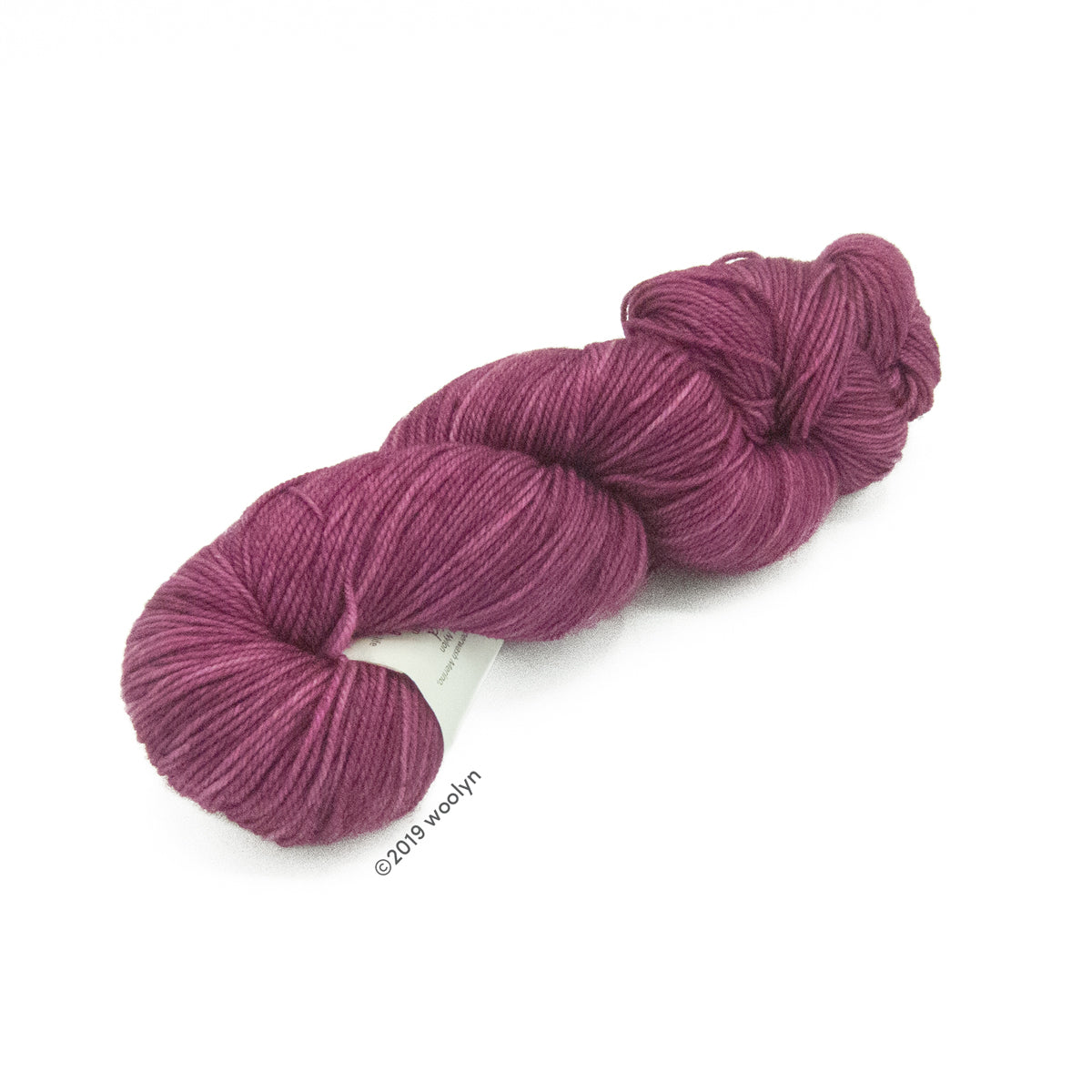 Hand dyed  fingering weight yarn in dark mulberry tonal  shades twisted into a skein.
