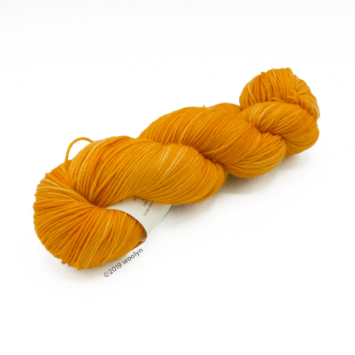 Hand dyed  fingering weight yarn in bright blue pumpkin orange shades twisted into a skein.
