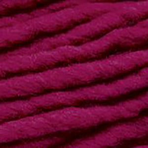 Close up of Brown Sheep Burly Spun in fuchsia.