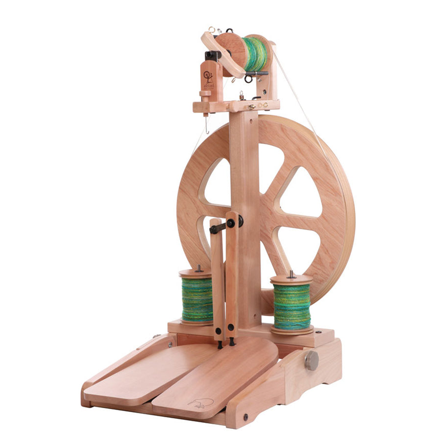 Angled front view of the Ashford Kiwi spinning wheel.