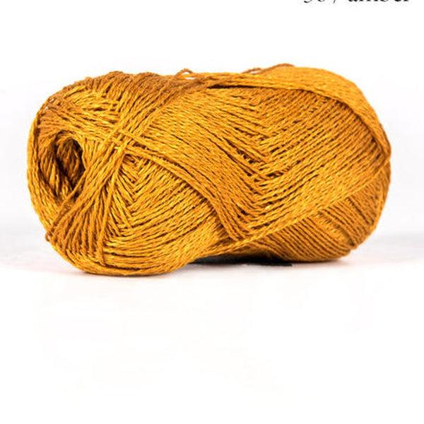 Skein of sport weight linen yarn from BC Garn.  Color is golden orange.