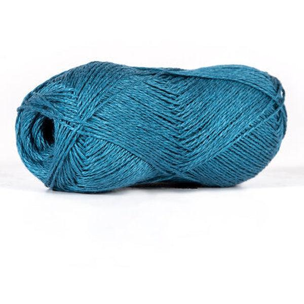 Skein of sport weight linen yarn from BC Garn. Color is a dark greyish blue.