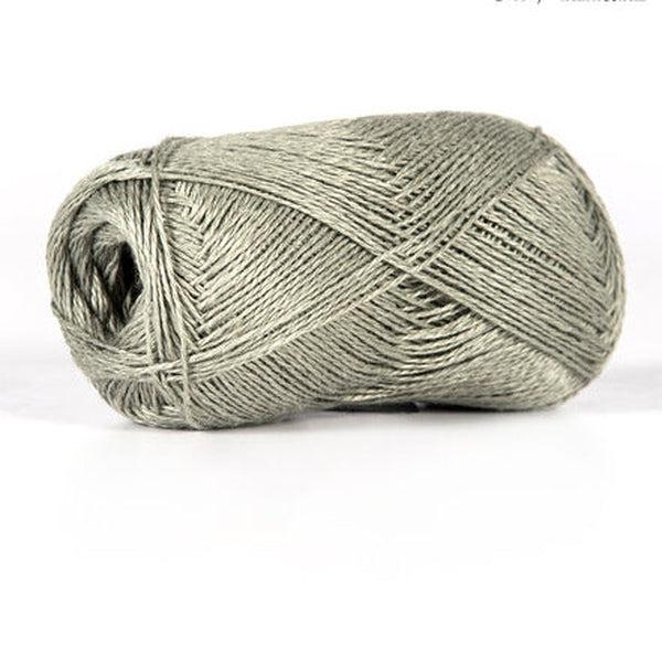 Skein of sport weight linen yarn from BC Garn. Color is a medium warm grey.