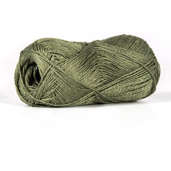Skein of sport weight linen yarn from BC Garn. Color is a dark green.