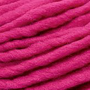 Close up of Brown Sheep Burly Spun in hot pink.