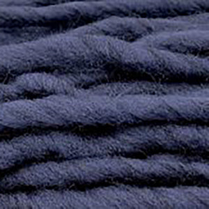 Close up of Brown Sheep Burly Spun in indigo.
