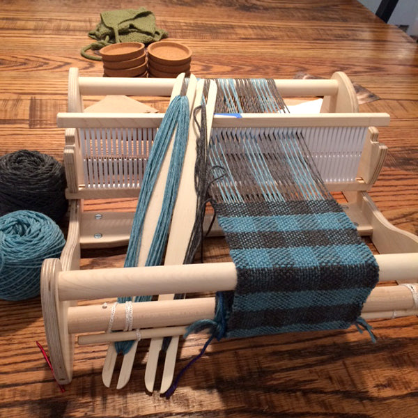 Blue and Grey checkerboard scarf being woven on a Cricket rigid heddle loom
