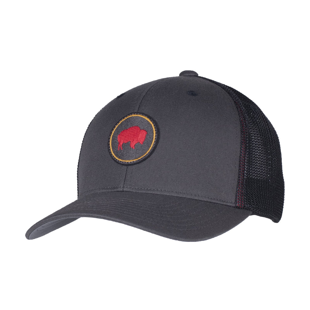 Trucker-style hat with charcoal gray brim and front panels and a black mesh back. Mountain Khakis signature circle bison patch featuring a red embroidered bison.