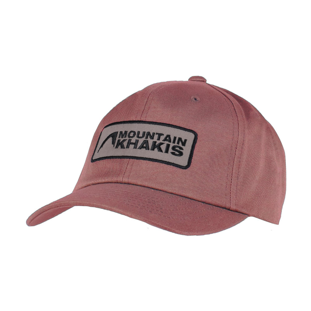 A classic-style cap in a muted red color. The Mountain Khakis logo is embroidered on a tan patch on the front of the hat.