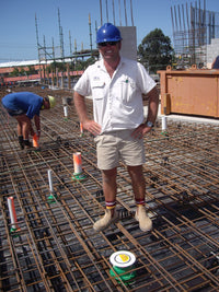 a builder happy using the wondercap on their job site. Preventing the concrete the plumbing!