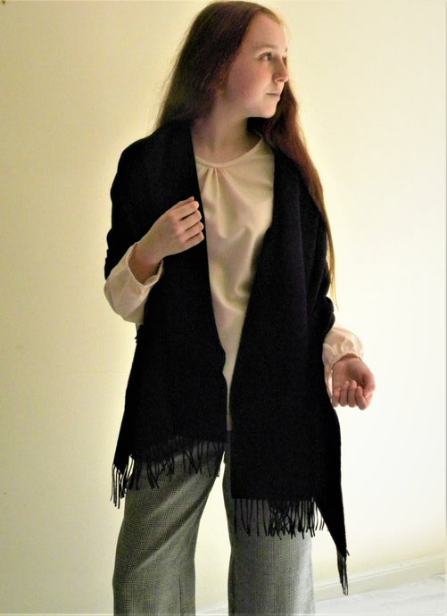 Think cozy with this soft Black scarf/ Shawl rich cashmere. Will add to your wardrobe an elegant stylish piece.