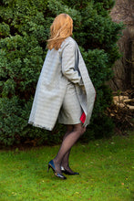 Load image into Gallery viewer, Unique look with our open sided  black and white check coat with contrast color red lining and  fringed hem