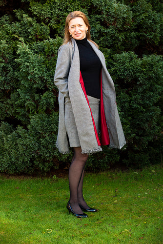 A timeless elegant black and white check coat with dark red lining, open-sided seam . Crafted using a 100% merino wool. To look classy, pair it with our smart fringe skirt