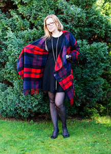 Pair your little black dress with the same length tartan cashmere coat to get elegant and stylish look