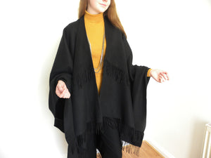 Boujee outfit,  a Black cape for a classy and elegant appeal.
