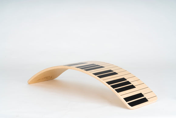 Piano wooden balance board with transparent lacquer