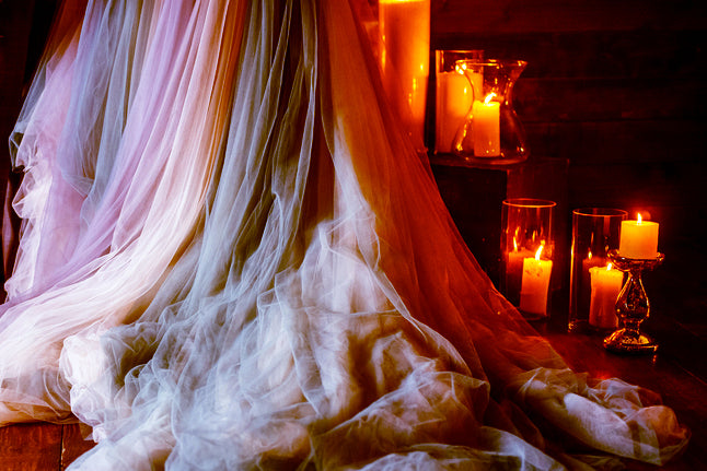 Layered Flowing Tulle Fabric with Candles Moody Atmosphere
