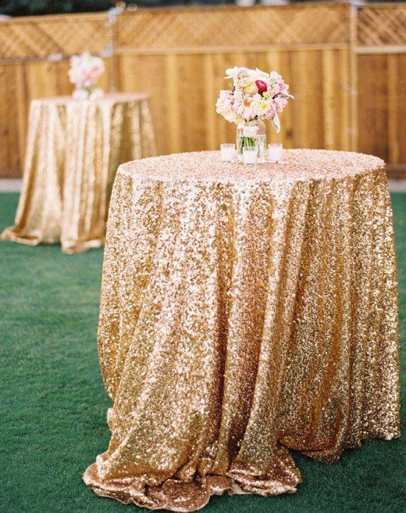 Gold sequin tablecloth on round cocktail table