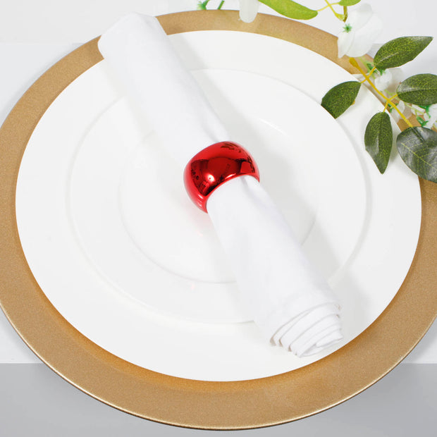Glitter gold charger plate with white dinner plate and white napkin with metallic red napkin ring