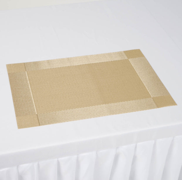 Gold Placemat on white tablecloth