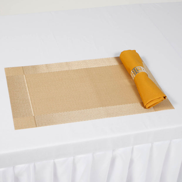 Gold Placemat with Gold Napkin on white Tablecloth