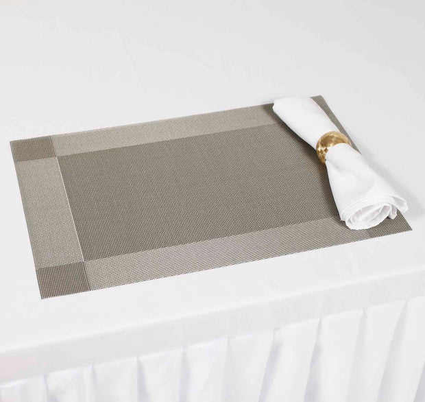 Silver Woven PVC Placemat with White Cloth Napkin and Gold Napkin Ring