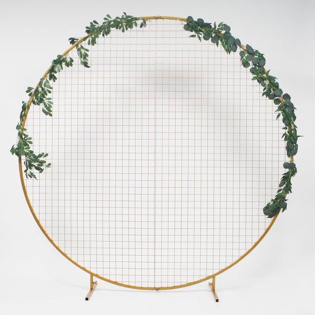 Large Gold Hoop Freestanding Wedding Arch with mesh inserts for hanging decorations. Decorated with Native Australian Eucalyptus leaf Greenery Garlands