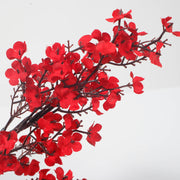 silk chery blossoms in red for events close up