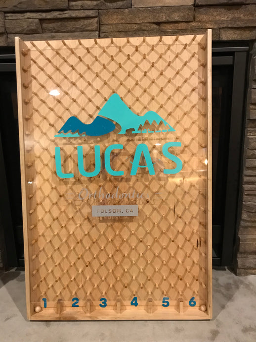 Large Plinko game with custom business logo for trade shows