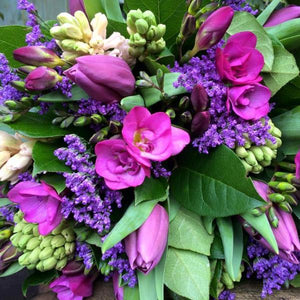 A bright hand tied posy of freesias, tulips and hyacinths  with petite foliage which is hand tied, aqua-packed and presented in a gift bag.