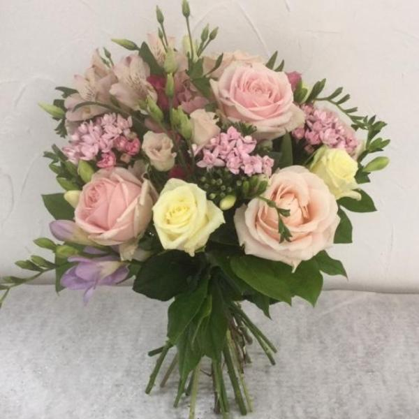 A selection of pink, pale pink and cream flowers including Sweet Avalanche Roses, Cream Avalanche Roses, Pink Bouvardia, Freesias, Pink Eustoma and foliage. Hand tied, aqua packed and presented in a gift bag.