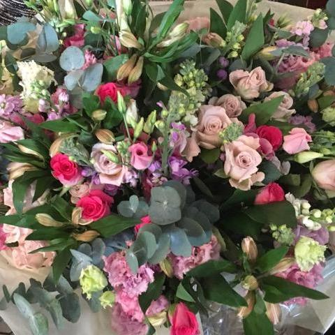 A beautiful bouquet of classic country flowers in shades of pink and cream including Sweetheart Roses, freesias, stocks, alstromeria and finished with eucalyptus. Hand tied, aqua packed and presented in a gift bag.