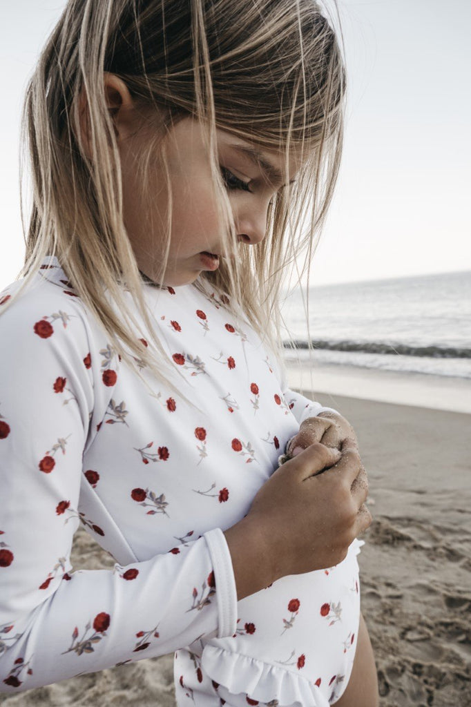 US stockist of Cocove Swim Long Sleeve White Bel Rashsuit with Red 65 Roses Print