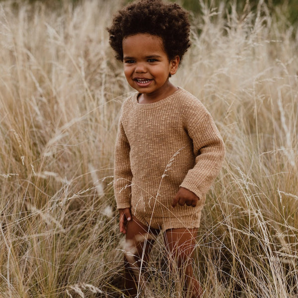 US stockist of Grown Clothing's gender neutral chunky knit sweater in warm brown.  Made from 100% Cotton.