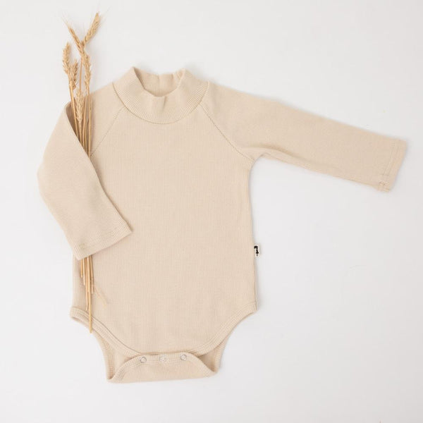 US stockist of Lacey Lane's coconut cream ribbed cotton bodysuit with turtleneck.