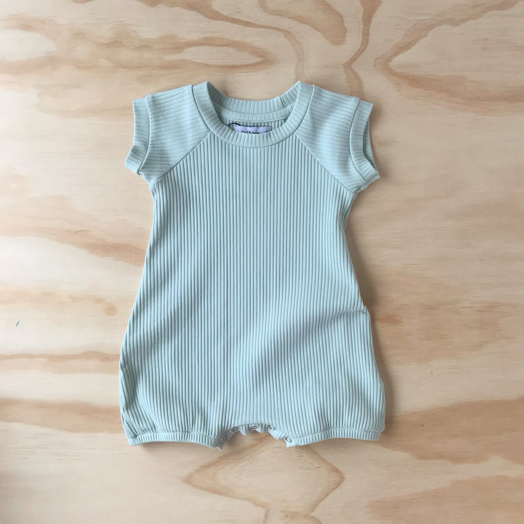 US stockist of Bel & Bow's gender neutral mint green ribbed cotton romper with short legs and short sleeves.