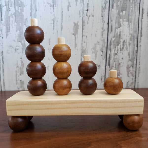 US stockist of Children of the Trees hand made, hand stained abacus mountain wooden toy.