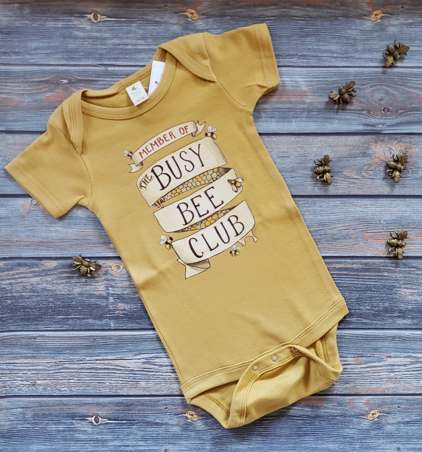 Raising Tito mustard yellow organic cotton short sleeve busy bee club bodysuit