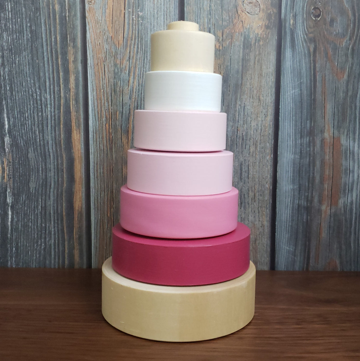 US stockist of Children of the Trees hand painted ring stacker wooden toy in pinks.