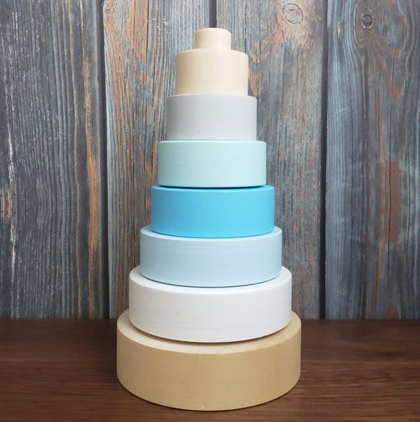 US stockist of Children of the Trees hand painted ring stacker wooden toy in blues and gold
