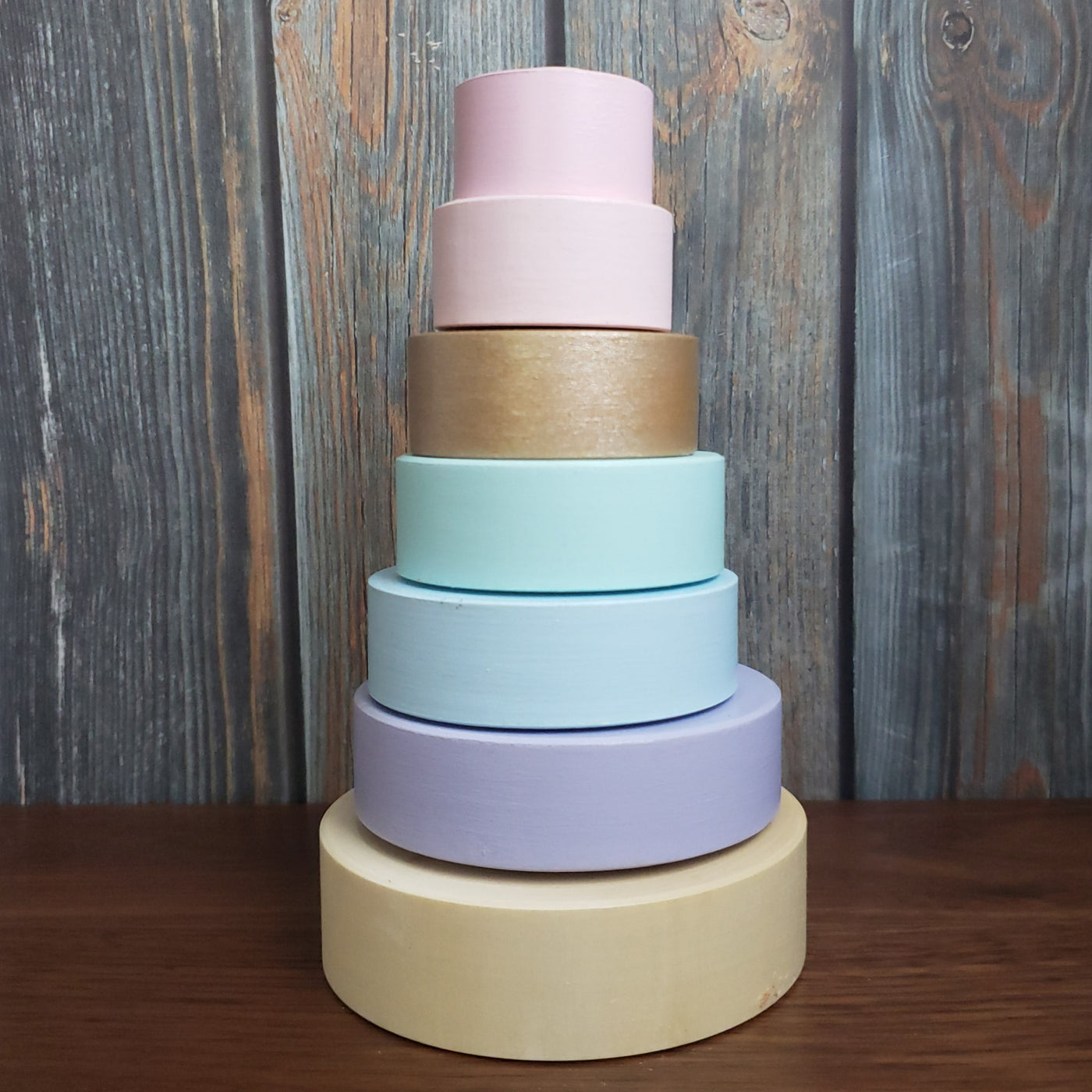 US stockist of Children of the Trees hand painted ring stacker wooden toy in pastel hues