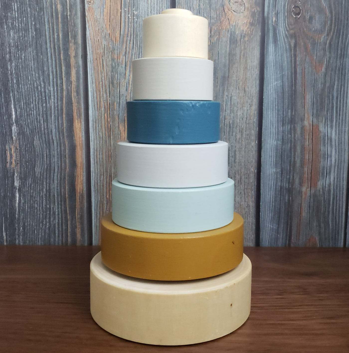 US stockist of Children of the Trees hand painted ring stacker wooden toy in blues and with a striking gold ring