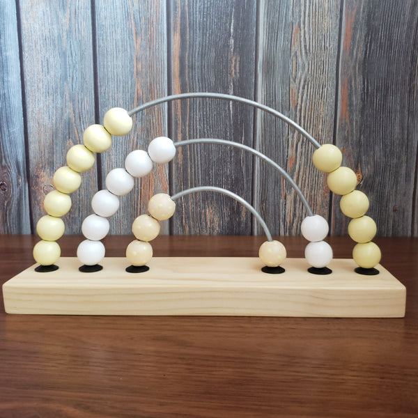 US stockist of Children of the Trees yellow polka dot abacus rainbow counter wooden toy