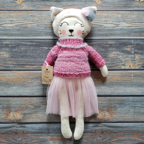 US stockist of Vasya & Vasya's heirloom quality, unique ballerina cat.  She is made from a cream linen fabric with a soft beige, plush head.  Face is hand embroided and hand painted.  She wears a pink hand knitted wool sweater and pink tulle skirt.