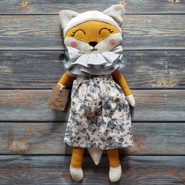 "US stockist of Vasya Vasya's heirloom quality, handmade orange fox.  Made from orange linen and soft cream plush.  She wears a beautiful linen/cotton floral dress and neck ruff.  Measures approximately 15"" in height."