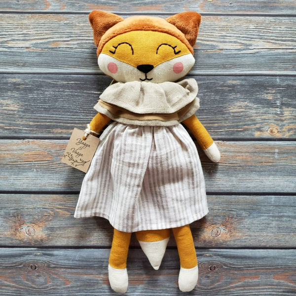 "US stockist of Vasya Vasya's heirloom quality, handmade orange fox.  Made from orange linen and soft plush.  She wears a beautiful linen striped dress and neck ruff.  Measures approximately 15"" in height."