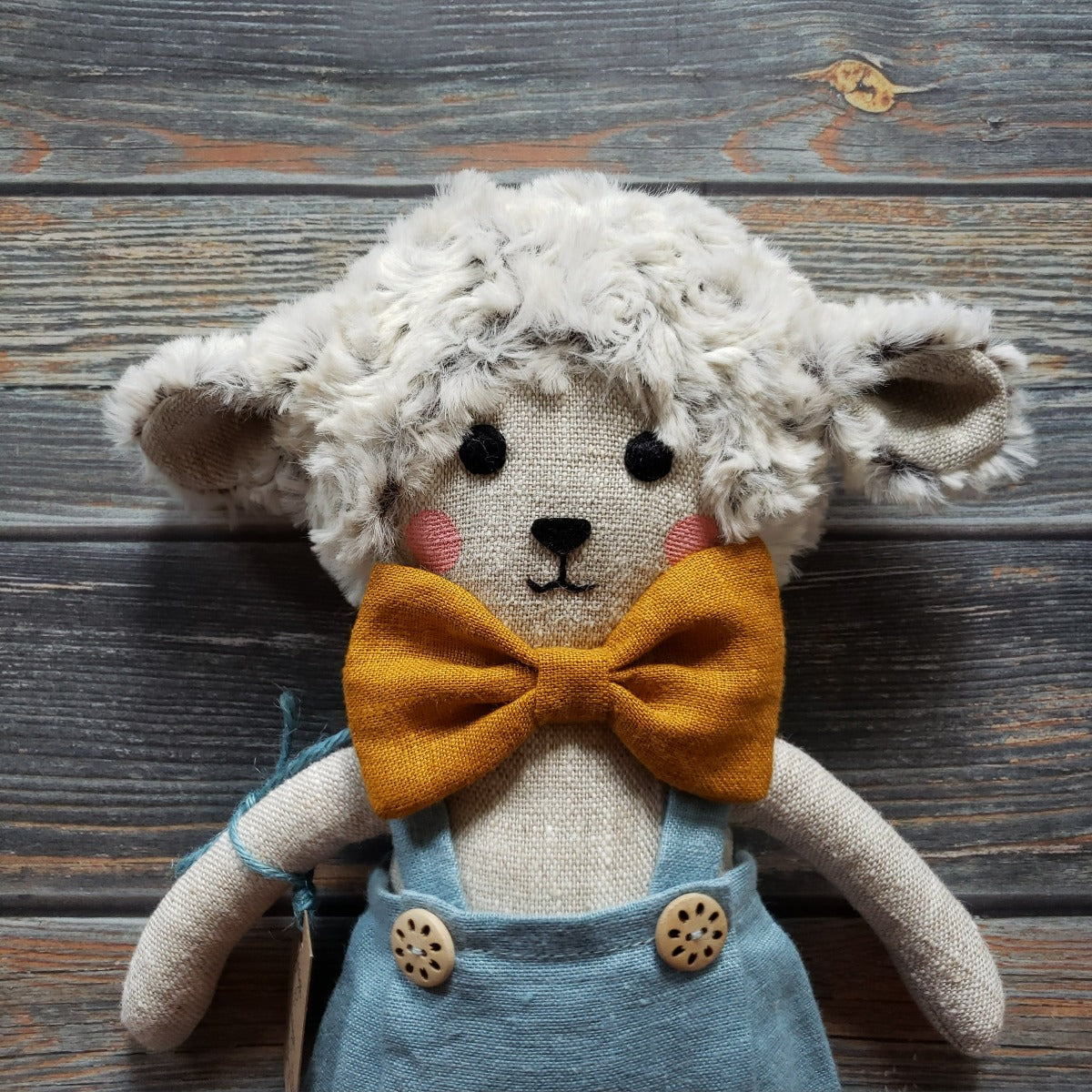 "US stockist of Vasya Vasya's heirloom quality, handmade light grey lamb.  Made from light grey linen and soft plush, he wears blue suspender pants and a mustard bow tie.  Measures approximately 15"" in height."