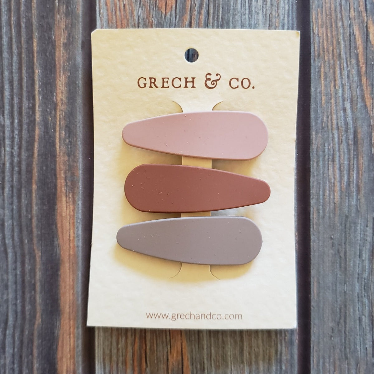 US stockist of Grech & Co's 3 pack of matte snap clip set in stone, shell and rust.