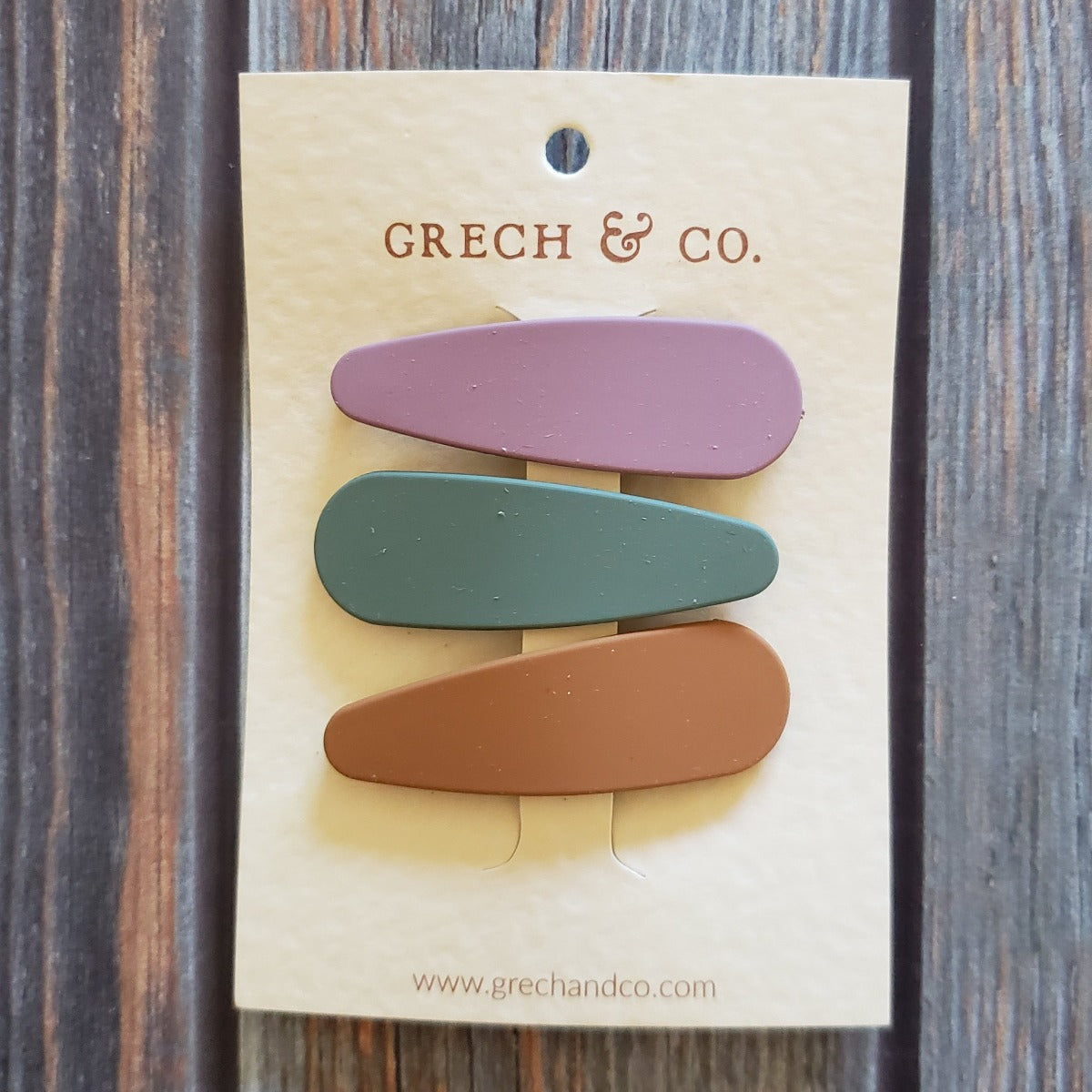 US stockist of Grech & Co's 3 pack of matte snap clip set in burlwood, fern green and spice.
