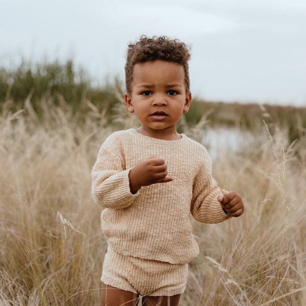 US stockist of Grown Clothing's gender neutral chunky knit sweater in Tan.  Made from 100% Cotton.